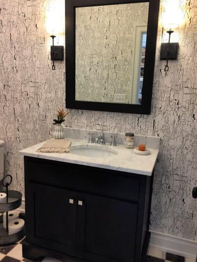 classic modern black & white powder room with black & white birch pattern wallpaper