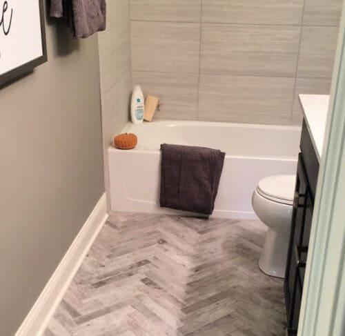 Neutral grey chevron bath tiles