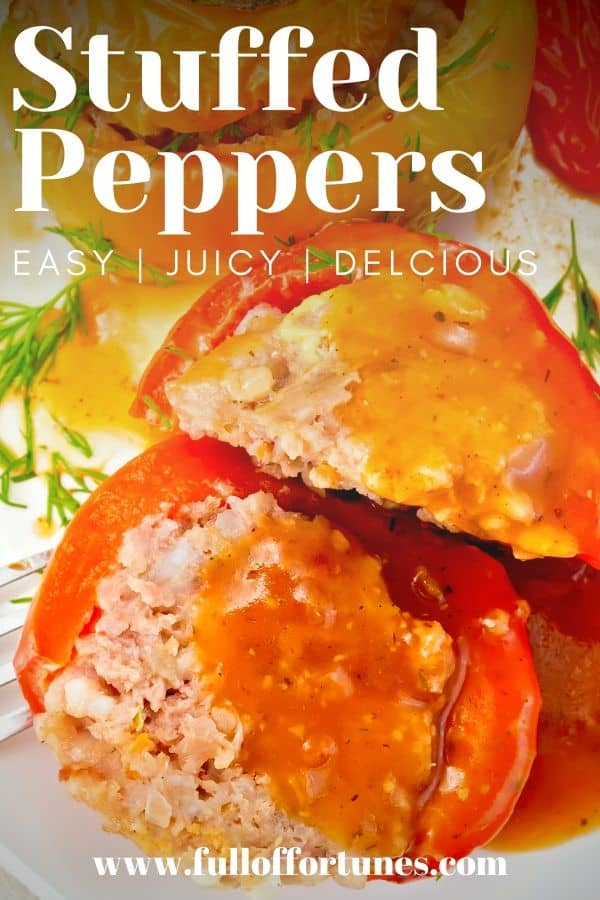 Close up of baked tri-colored meat stuffed peppers topped with tomato sauce