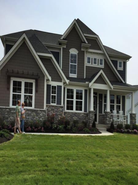 Modern contemporary gray house with white trim and pergolas