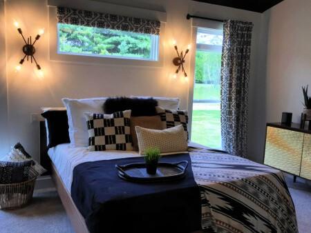 Mid Century Modern Bedroom with sputnik sconces, serving tray, & gold metal dresser
