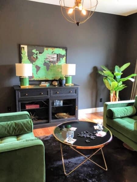 Mid century modern gentlemen's den with green velvet chairs