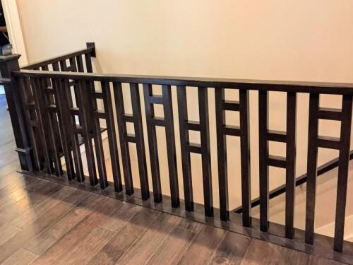 modern grid style aluminum stair rails & wood plank floors